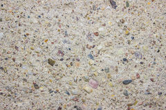Colored stones in cement (can be used as background) Stock Photos