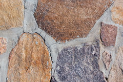 Colored stones on a grey background Stock Images