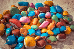 Colored stones lying on a flat surface Royalty Free Stock Images