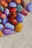 Colored stones lying on a flat surface Stock Photography