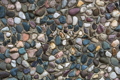 Colored stones. On the wall Stock Image