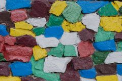 Colored stones on the wall, background for designers. stock photo