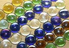 Colored stones on a wooden table Royalty Free Stock Image