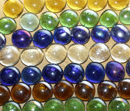 Colored stones on a wooden table Royalty Free Stock Photos