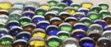 Colored stones on a wooden table Stock Photography