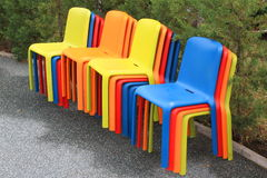 Colored stools. Ordered placed at the edge of an alley Stock Photography