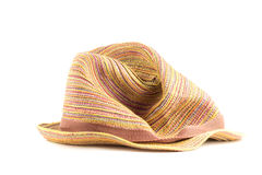 Colored straw hat on a white background. Crumpled straw hat color full face on a white background Royalty Free Stock Images