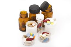 Colored stream of pills and pill bottles Royalty Free Stock Images
