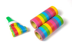 Colored streamers and white table Royalty Free Stock Image