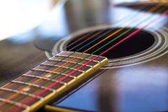 Colored strings on guitar. Guitar, neck with colored strings Royalty Free Stock Photography