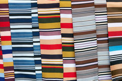 Colored striped cloth. The background of colored striped clothes Stock Photography