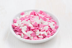Colored sugar hearts in a white bowl Stock Images