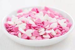 Colored sugar hearts in a white bowl, close-up, selective focus. Colored sugar hearts in a white bowl, close-up, horizontal royalty free stock photos