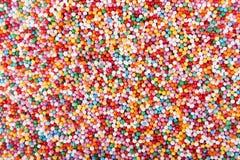 Colored sugar pellets background. Composition of colored sugar pellets background Stock Photography