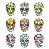 Colored sugar skull icons set. Colored sugar skull isolated on white background. Mexican hand drawn calavera set for halloween or day of the dead, dia de los Royalty Free Stock Image