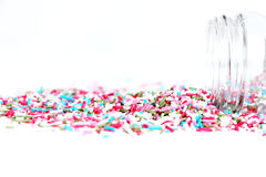 Colored sugar sprinkles and its container Royalty Free Stock Images