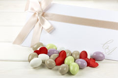 Colored sugared almonds and wedding paper Royalty Free Stock Photography