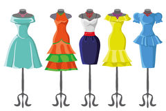 Colored summer dresses on mannequin.Fashion set Stock Image