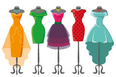 Colored summer dresses on mannequin Stock Images