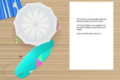 Colored sun umbrellas, surfboard, flip-flops and a beach Mat on the wooden backgroun Royalty Free Stock Images