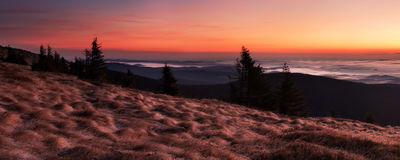 Colored sunrise in the hills Royalty Free Stock Photography