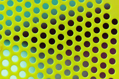 Colored surface with holes. Royalty Free Stock Photos