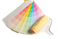 Colored swatches for choose paint sample and paint roller on the white background Royalty Free Stock Image