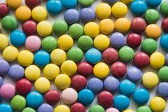 Colored sweet dragee background Royalty Free Stock Images