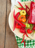 Colored sweet peppers and hot chili peppers Stock Photo