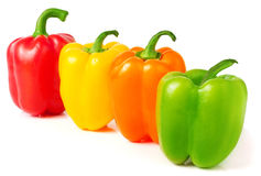 Colored sweet peppers on a white background Royalty Free Stock Image
