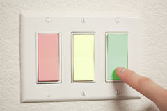 Colored Switches. A 3-way switch, colored red, yellow, and green Royalty Free Stock Images