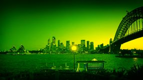Colored sydney landmarks. Green colored sydney panorama, opera house and harbor bridge in picture Stock Photos