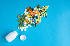 Colored tablets in plastic container top view Royalty Free Stock Photos