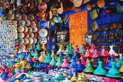 Colored Tajine, plates and pots out of clay on the market in Mor stock image