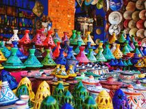 Colored Tajine, plates and pots out of clay on the market in Mor stock photos
