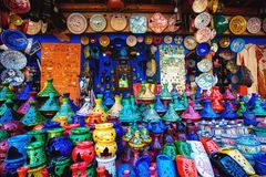 Colored Tajine, plates and pots out of clay on the market in Mor stock images