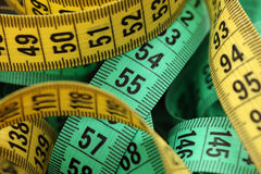Colored tape measures Stock Photography