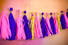 Colored Tassel Garland. Decoration for birthday. concept carnival royalty free stock image