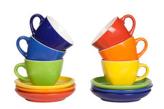 Colored tea cups and saucers. Colored tea cups and saucers, isolated on white Royalty Free Stock Image