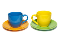 Colored teacups and saucers Stock Images