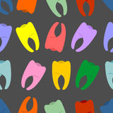 Colored teeth on a grey background seamless pattern. Vector hila Royalty Free Stock Photos