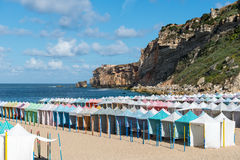 Colored tents on the beach, Nazare (Portugal) Stock Images