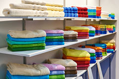 Colored terry towels on shop shelves Stock Photography