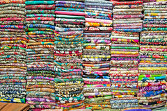 Colored textile in a traditional east bazaar in Vietnam. Stock Photography