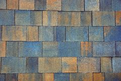 Colored texture of a fragment of paving bricks on the road Stock Images