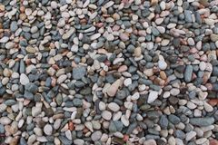 Colored texture pebbles on the beach. stones of different shapes and sizes royalty free stock photo