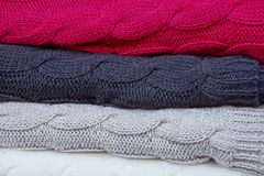 Colorful bright background of woolen clothes in a pile Stock Photos