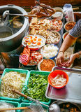 Colored thai food in floating market, food seller in Thailand Stock Image