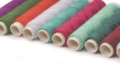 Colored thread bobbins Royalty Free Stock Photos