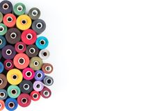 Colored thread coils on a white background, sewing supplies, text ready, banner, book or magazine cover Stock Photo